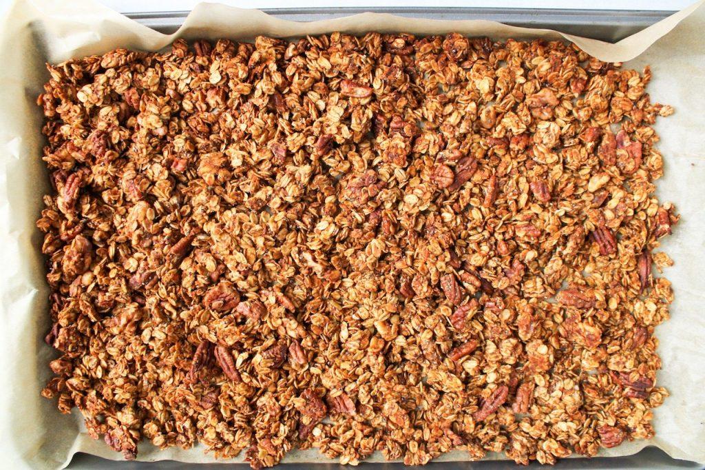 Close up on homemade granola still on the baking sheet.