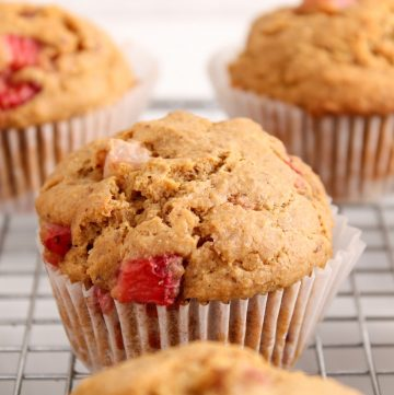 Showing are a few vegan strawberry muffins placed on a cooling rack