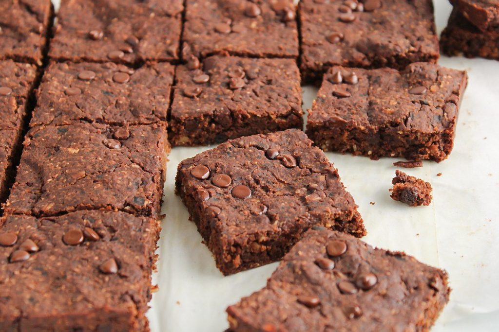 Close up on a vegan black bean brownies that was just sliced into squares.