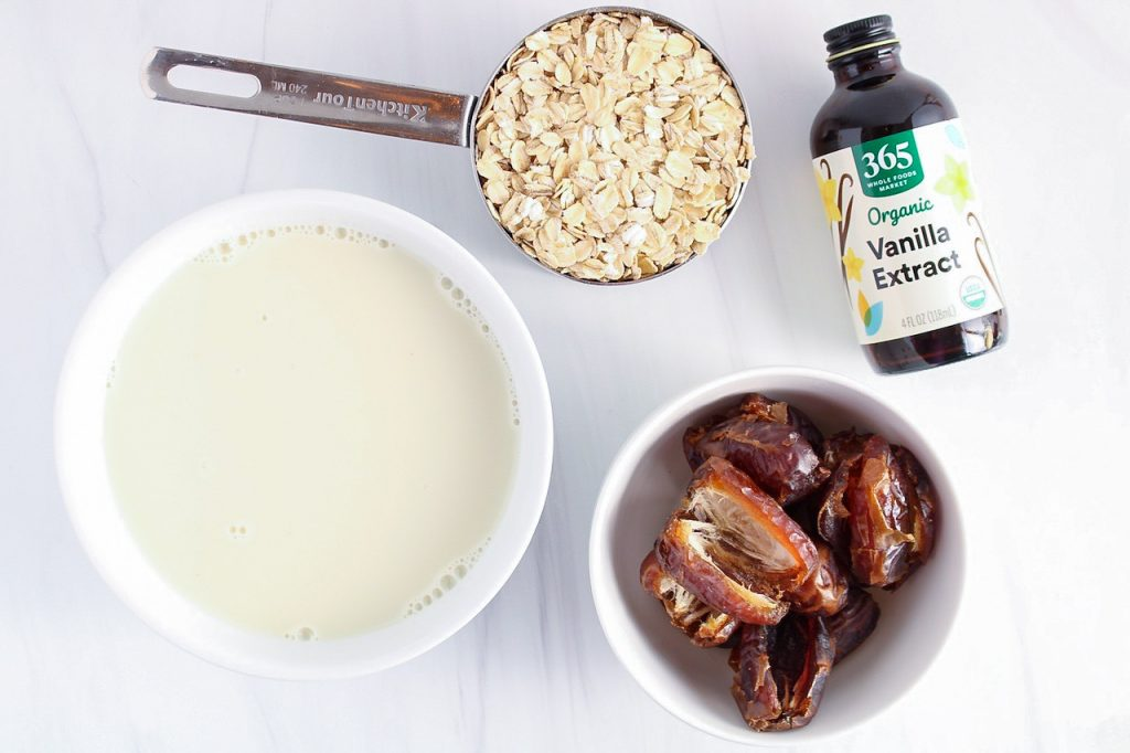 Ingredients needed to make the ice cream filling: vegan milk, medjool dates, vanilla extract and raw oats.
