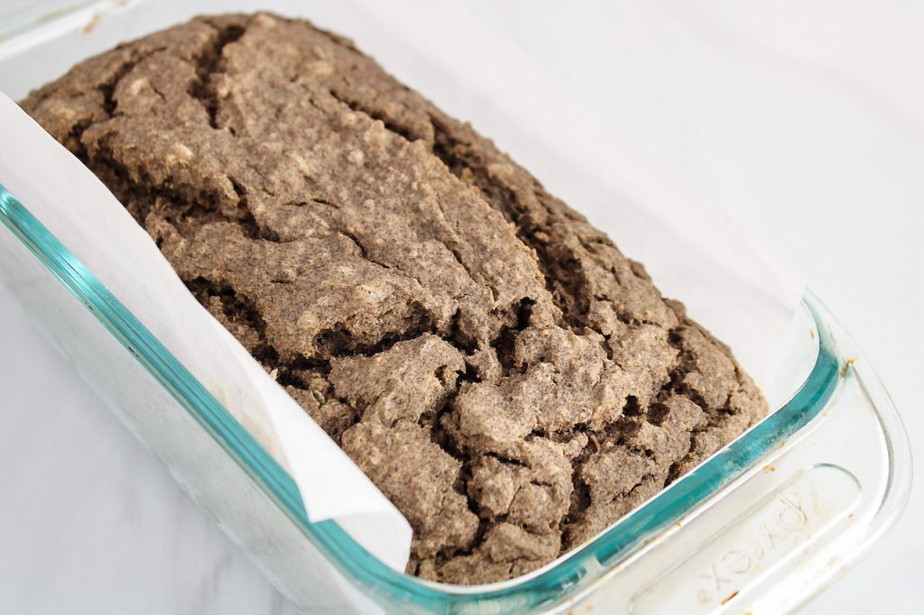 Close up on a homemade buckwheat bread that was just cooked and still is in its baking dish