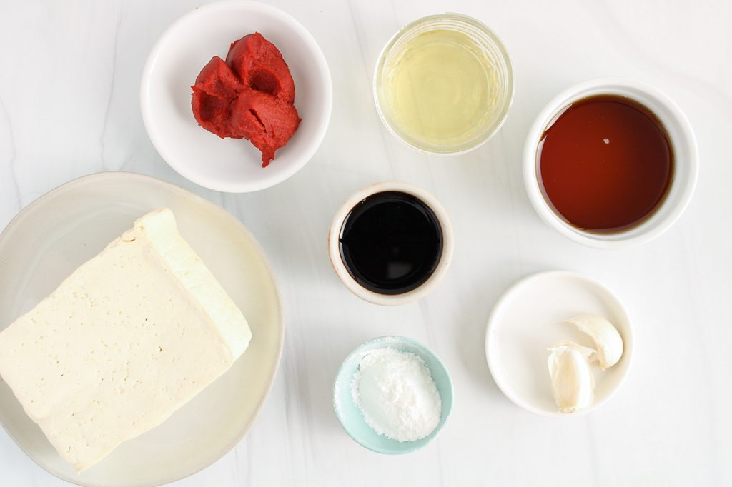Ingredients needed to make this recipe: tofu, tomato paste, corn starch, soy sauce, rice vinegar, garlic and maple syrup.