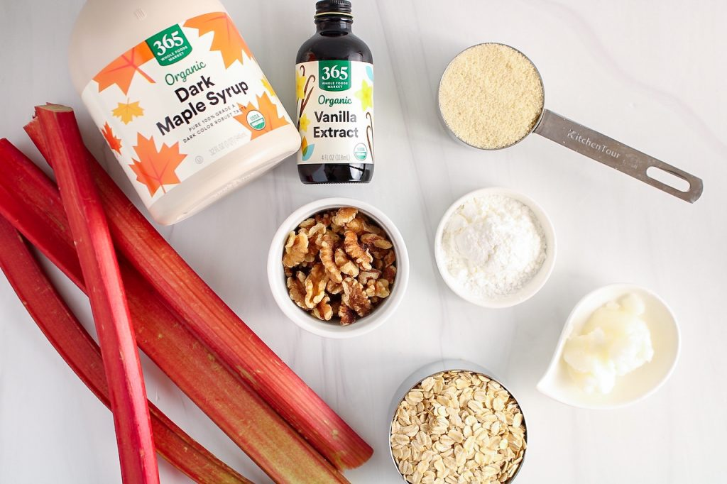 Ingredients needed to make this recipe: rhubarb, maple syrup, vanilla extract, almond flour, rolled oats, coconut oil, cornstarch and walnuts.