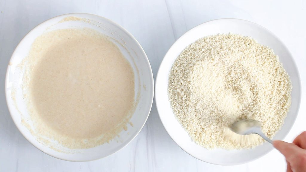 In process picture: there are 2 white bowls containing either a batter or a panko mixture