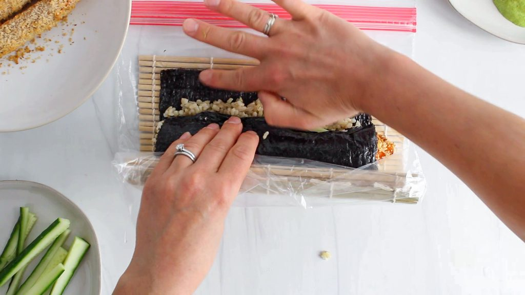 In process picture: you can see a hand that's rolling a sushi