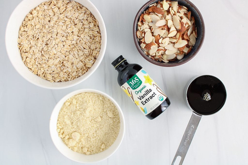 Showing are the ingredients needed to make this recipe, you can see rolled oats, nuts, flour, maple syrup and spices.