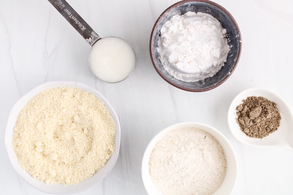 Showing are the ingredients needed to make this recipe: almond flour, rice flour, tapioca starch, coconut oil and ground chia seeds.