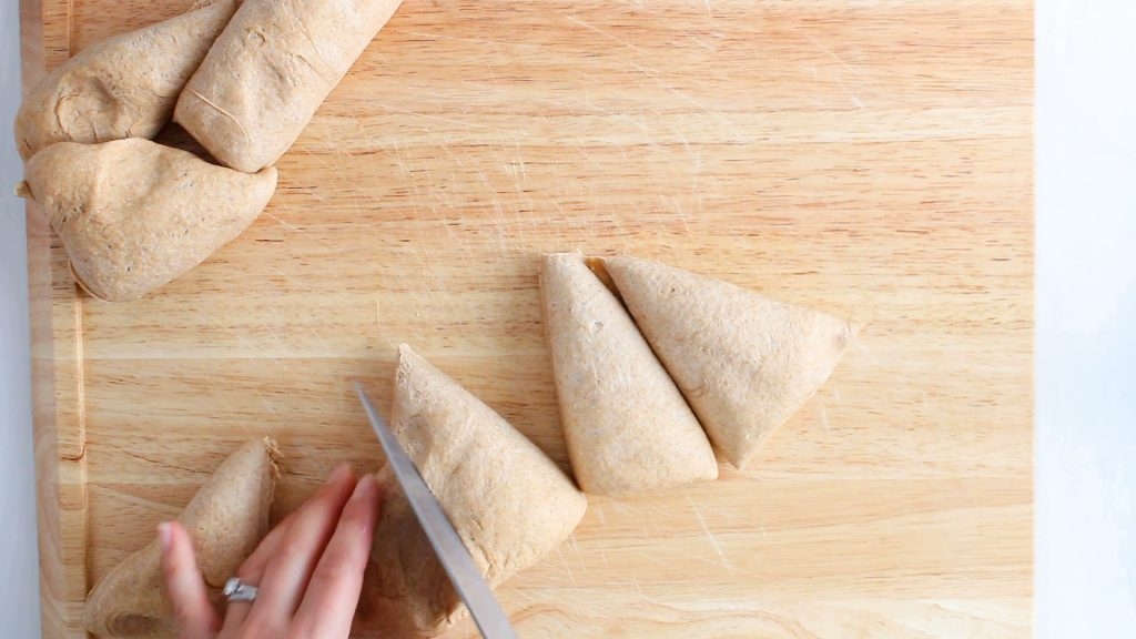 There is a knife that's cutting a dough in 8 equal portion.