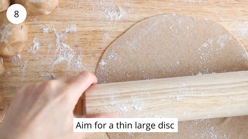In process picture: there is a rolling pin that's rolling a ball of dough into a large thin disc.